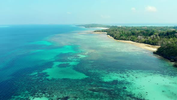 Thumbnail for Aerial: flying over tropical beach island coral reef dreamlike turquoise caribbean sea Indonesia