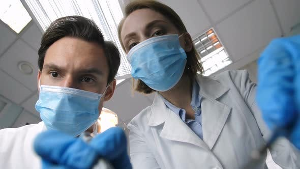Thumbnail for Medical Dental Staff Treating Patient