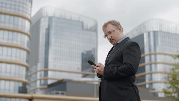 Thumbnail for Funny Plump Man in Suit Texting on Smartphone and Looking Into Camera, Adult Manager Outside Office