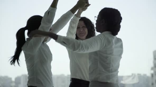 Cover Image for Cheerful Multiethnic Businesswomen Dancing