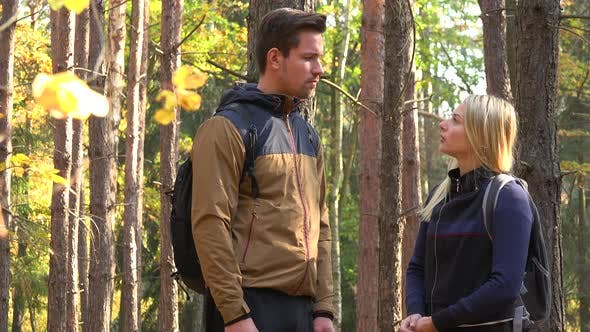 Thumbnail for A Hiking Couple Stands in a Forest and Talks