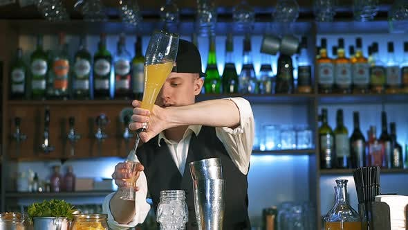 Thumbnail for The Bartender Is Preparing an Alcoholic Cocktail.