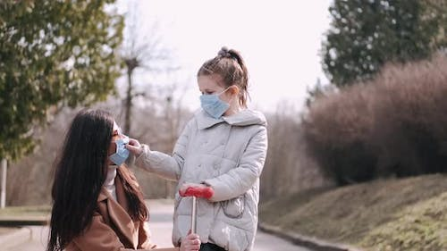 Mother and Daughter Are Wearing Disposable Masks