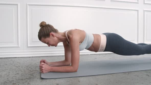 Woman in Plank Pose on Mat