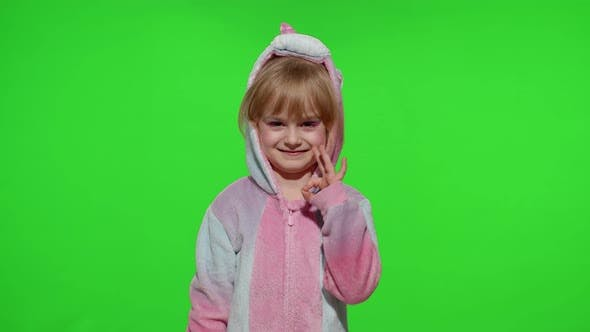 Thumbnail for Little Child Girl Smiling Showing Ok Gesture Agree Sign in Unicorn Pajama on Chroma Key Background