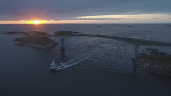 Thumbnail for Atlantic Ocean Road in Norway at Sunset. Ship Is Passing Under Storseisundet Bridge
