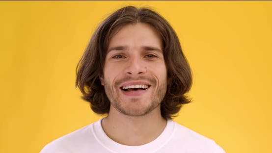 Young Happy Caucasian Man Laughing at Camera, Feeling Excited and Glad, Close Up Portrait