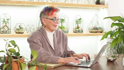 Modern Caucasian Woman 50-60 Years Old Sit Working with Laptop