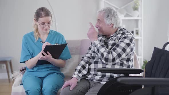 Thumbnail for Professional Caucasian Nurse Talking with Elderly Male Patient and Writing Down Symptoms. Elderly