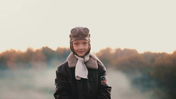 Thumbnail for Beautiful Medium Portrait of Little Girl in Vintage Pilot Costume Putting on Old Aviation Glasses