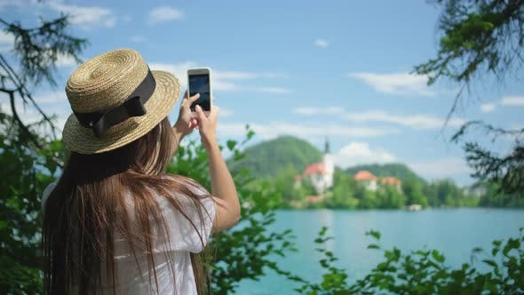 Photographing By Smartphone European Landscape and Landmark on Lake Bled