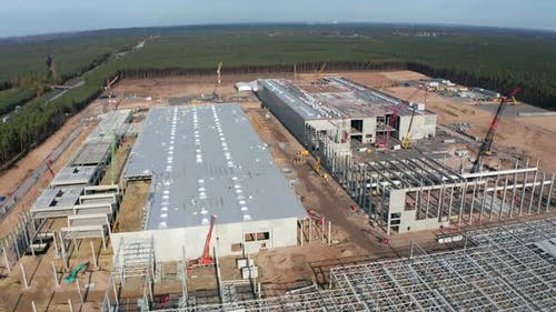 Huge Construction Site and Structures of Factory Building Being Built in Germany, Aerial View