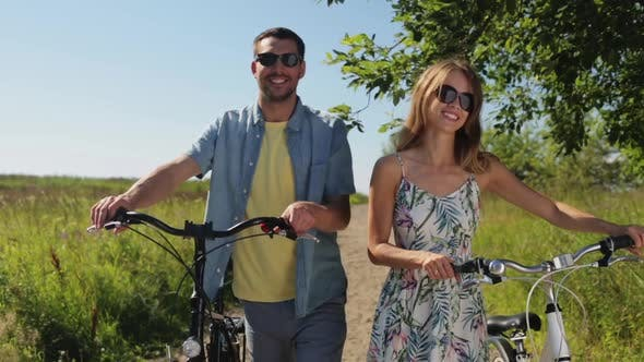 Thumbnail for Happy Young Couple with Bicycles Walking in Summer 6