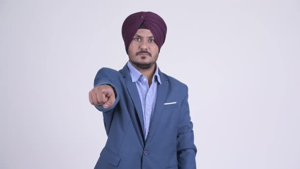 Thumbnail for Happy Bearded Indian Sikh Businessman Pointing at Camera