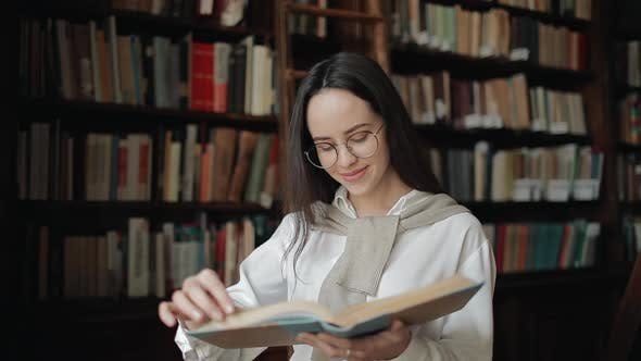 Thumbnail for Close Up of Smiling Girl Reading Book
