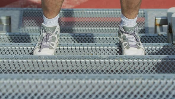 Thumbnail for Sportive person jumping on stairs