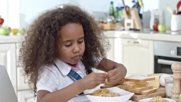 Thumbnail for Little Girl Having Dinner