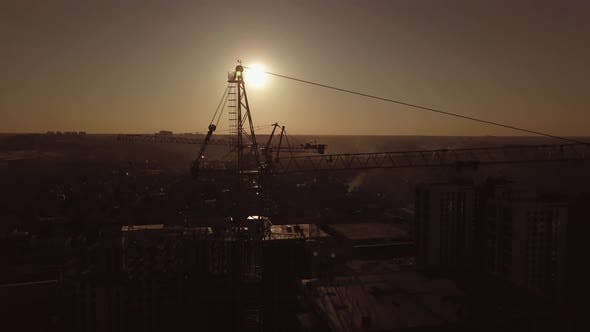 Thumbnail for Construction Site at Sunset. Silhouette of a Construction Crane Near the Building