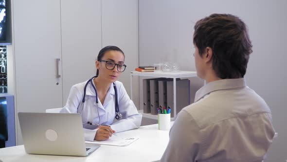 Thumbnail for Therapist Talking with Male in Hospital