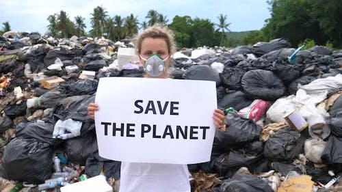 Woman Activist With Save The Planet Poster On Waste Dump. Recycle, Eco, Reuse.