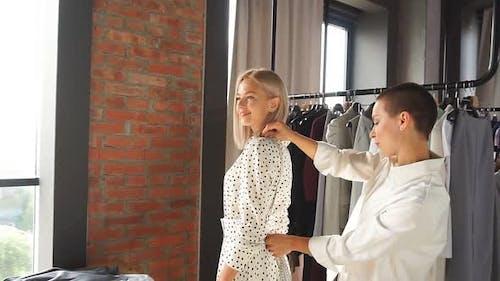 Dressmaker Is Measuring Beautiful Female