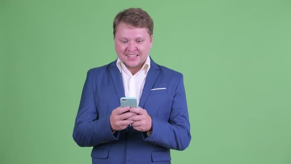 Thumbnail for Happy Overweight Bearded Businessman Using Phone