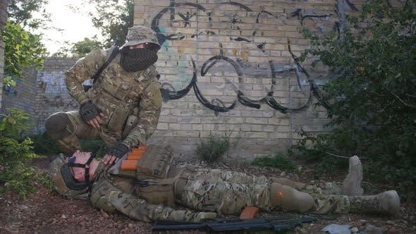 Thumbnail for Battlefield Medic Saving Life of Injured Infantryman