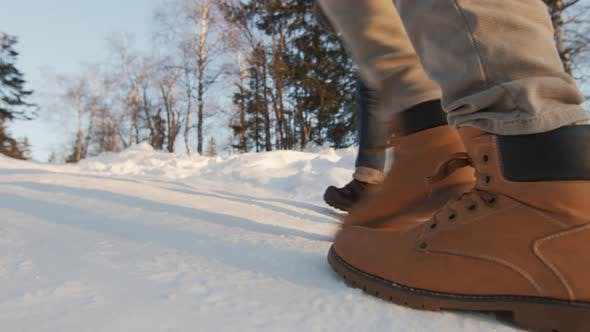 Thumbnail for Unrecognizable Feet On Winter Road