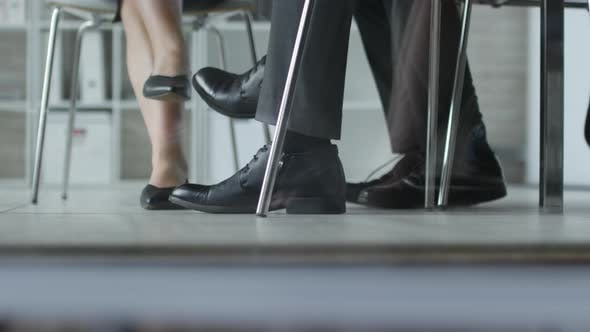 Thumbnail for Legs of Business Team Sitting at Office Table