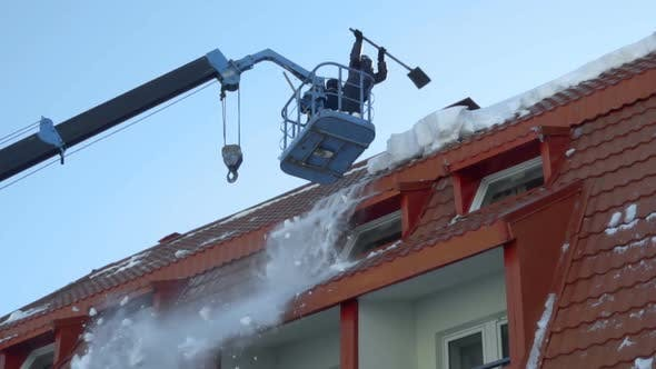 Thumbnail for Worker Removing Snow on the Roof of the Building