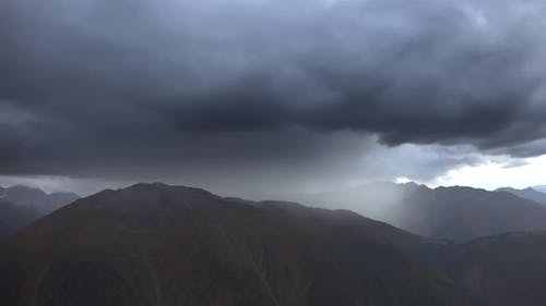 Rain Approaching Comes From the Gloomy Mountain Ridges