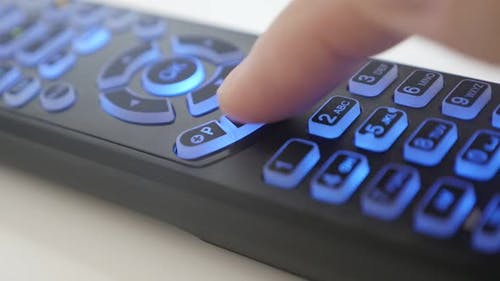 Slow motion  pressing buttons on  TV remote control slow motion video