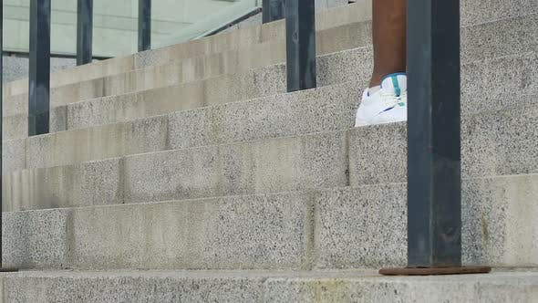 Thumbnail for Black Man in White Sport Shoes Jogging on Stairs, Sport Lifestyle, Wellness