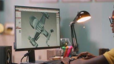 Black Man Browsing 3D Model on Computer