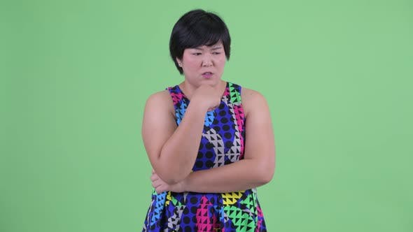 Thumbnail for Stressed Young Overweight Asian Woman Thinking and Looking Down