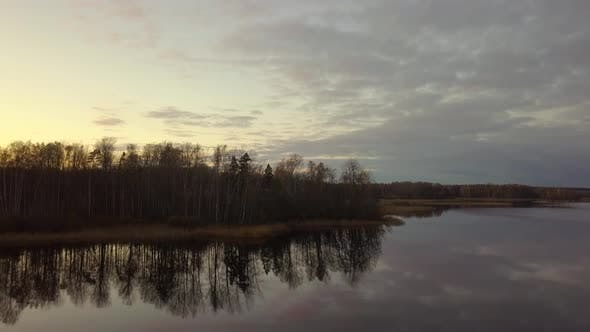 Thumbnail for Aerial the Morning Drone, Autumn Sunrise, Reflections on Water Surface and Forest