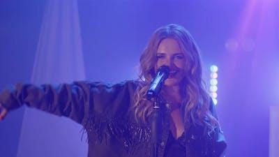 Live Vocal Performance of Emotional Singer in Denim Jacket