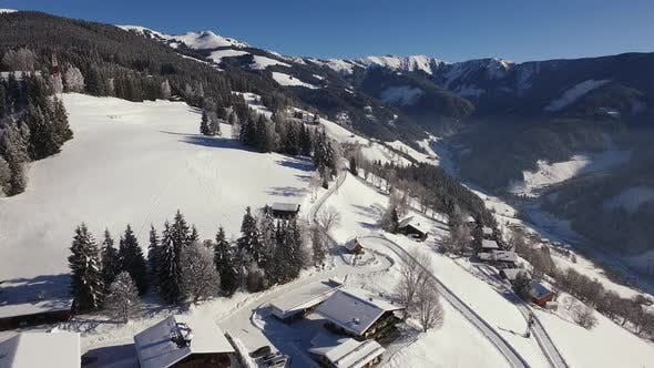 Thumbnail for Aerial view of houses on a snowy mountain