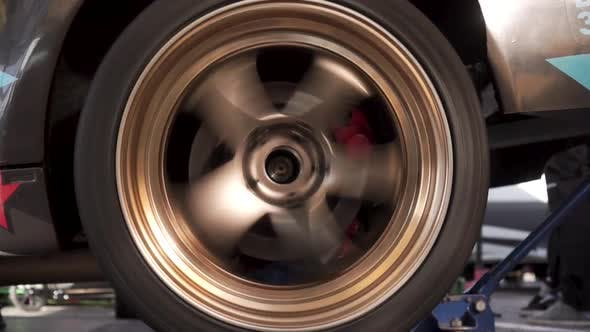 Closeup of Sport Car Gold Color Rotating Wheel