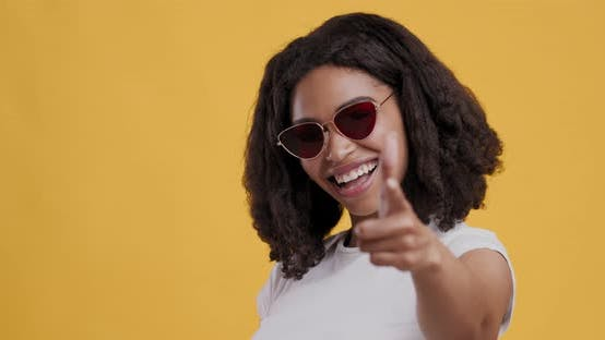 Thumbnail for Black Woman in Sunglasses Indicating Happily at Camera