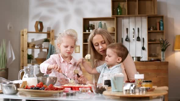 Cover Image for Lovely Caucasian Mother Baking with Kids at Home