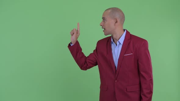 Thumbnail for Happy Bald Multi Ethnic Businessman Touching Something and Giving Thumbs Up