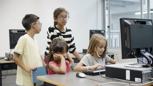 Multiethnic Children Studying Together at Computer School