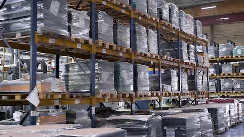 Large Warehouse with the Company's Products. Tall Steel Racks with Finished Products Await Shipment