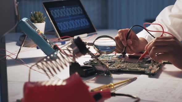 Thumbnail for View of Woman's Hands Testing Motherboard in Laboratory