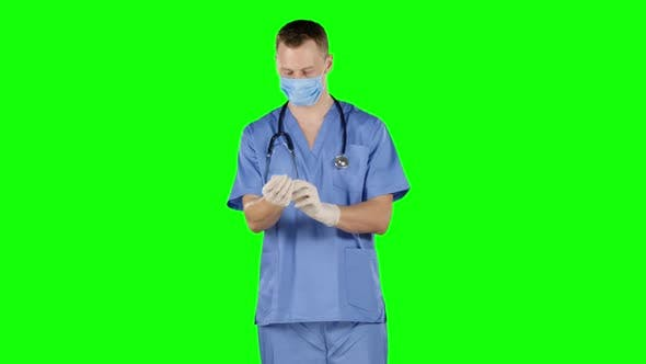 Thumbnail for Man Take Off and Puts on His Surgical Gloves. Green Screen