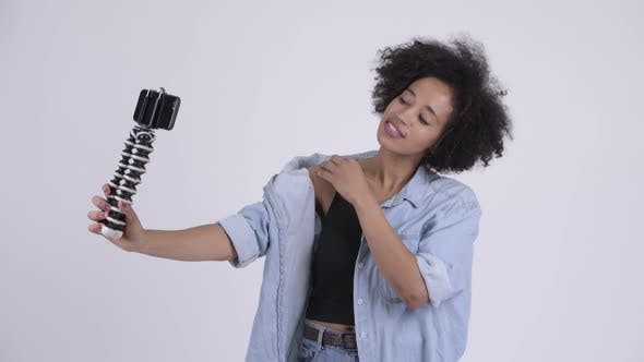 Thumbnail for Young Happy African Woman Vlogging with Phone