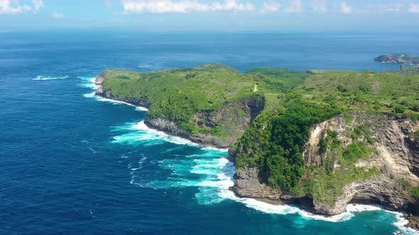Thumbnail for Kelingking beach, Nusa Penida, Bali, Indonesia. Aerial view at sea and rocks.