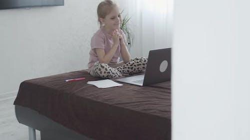 First Grader Girl Uses Laptop