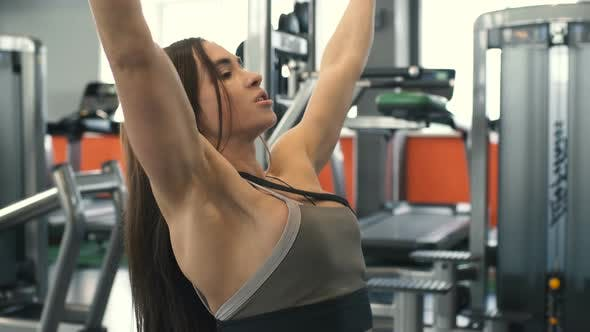Cover Image for Young Beautiful Muscular Woman Bodybuilder Is Engaged In Gym And With Dumbbells